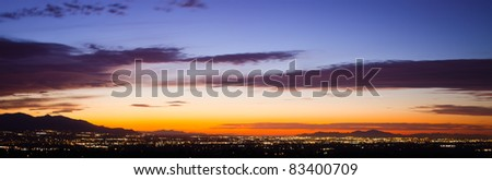 A wide shot looking out over Salt Lake City during a summer sunset. - stock photo