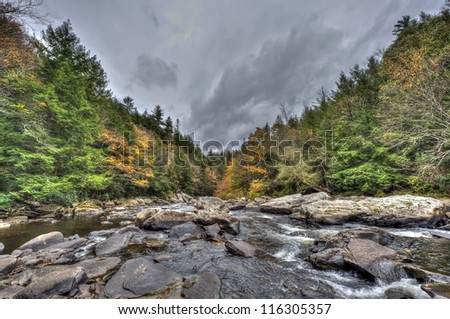 A wild river in the Appalachian mountains during Autumn - stock photo