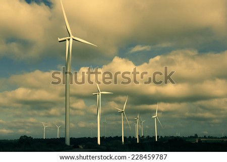 A Wind Turbine on a Wind Farm. - stock photo