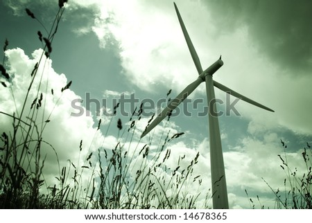 A wind turbine shot from a low angle. - stock photo