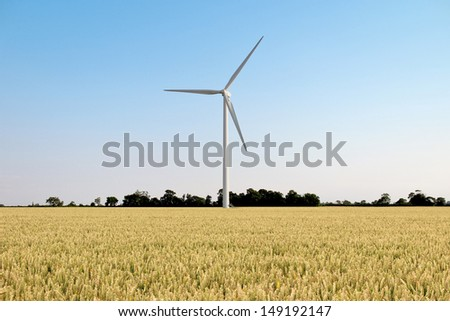 A Wind Turbine with Blue Sky and Countryside - stock photo
