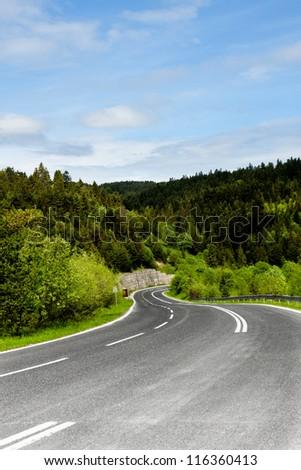 A winding mountain road - stock photo