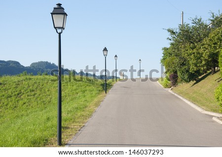 A winding road in the countryside in Switzerland - stock photo
