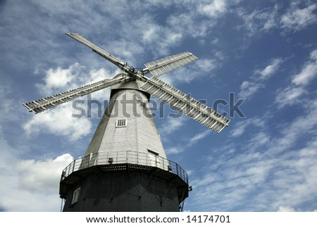 a windmill and sky - stock photo