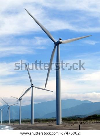 A windmill farm - stock photo