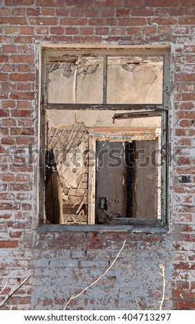 A Window in Destroyed building. Concept demolition, war, earthquake, catastrophe, disaster - stock photo
