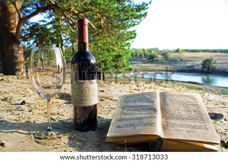 a wine glass and a bottle of wine - stock photo
