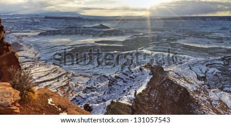 A winter sunrise panorama seen from the Dead Horse Point overlook in  Dead Horse Point State Park, Utah. - stock photo