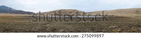 A woman alone on Mt.Aso grass field, Panorama - stock photo