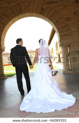 A woman and man, bride and groom at wedding ceremony at church - stock photo
