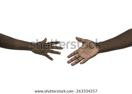 A woman and man hands reaching for each other - stock photo