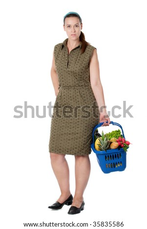 A woman as a shopper with shopping basket on white. - stock photo