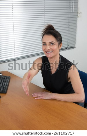 A woman at work want to check hand  - stock photo