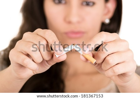 A woman breaking cigarette. concept stop smoking - stock photo