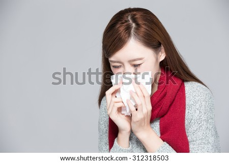 A Woman catches a cold, illness, asian - stock photo