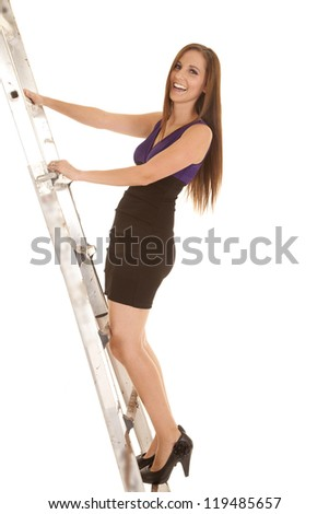 a woman climbing up a ladder to success in either business or school. - stock photo