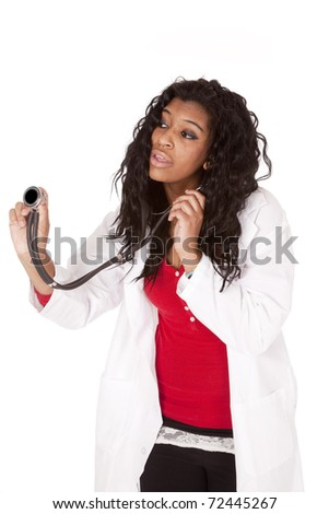A woman doctor is holding out her stethoscope. - stock photo