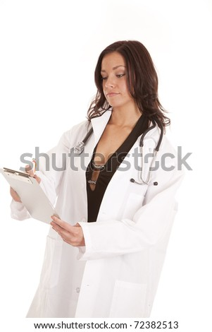A woman doctor is looking down at a chart writing. - stock photo