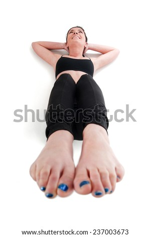 A woman doing exercise for stomach muscle - stock photo