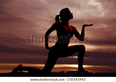 A woman doing yoga in the sunset. - stock photo