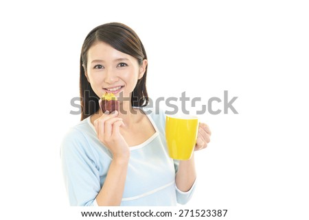 A Woman Eating Sweet Potato - stock photo
