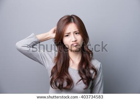 A Woman feel headache, illness,asian beauty,gray background - stock photo