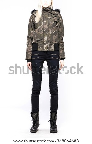 A woman(female, girl, model) wearing khaki(military) jumper, black pants(jeans, denim, trousers), black boots(walker) for winter close up isolated white at the studio. - stock photo
