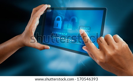 a woman finger sign a password on a tablet  - stock photo