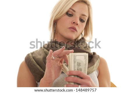 A woman flipping through a stack of money. - stock photo