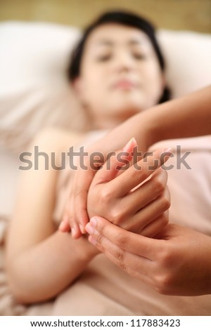 A woman getting manicure at a day spa - stock photo