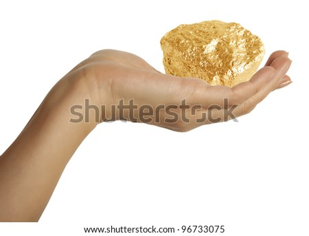 A woman hand holding a Gold Nugget - stock photo
