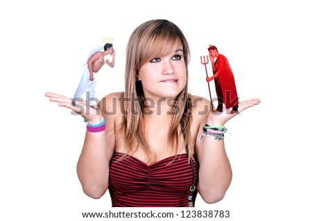 A woman has a devil in one hand and an angel in the other on white background - stock photo