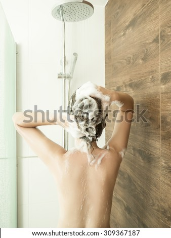 A woman having a shower - stock photo