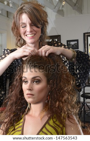 A woman having her hair styled at the salon - stock photo