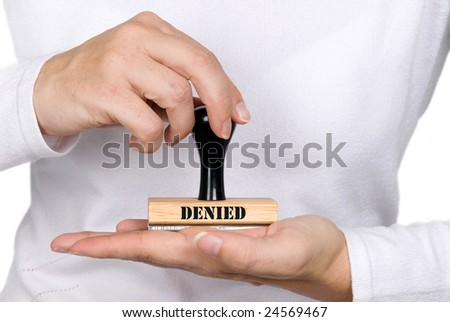 A woman holding a denied authorization stamp - stock photo