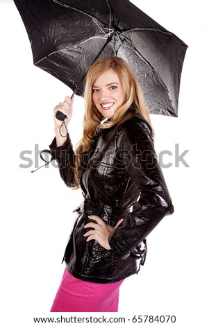 A woman holding her umbrella happy that she is dry. - stock photo