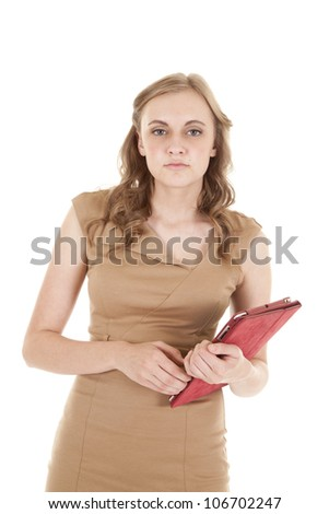 A woman holding on to her tablet in her business dress. - stock photo