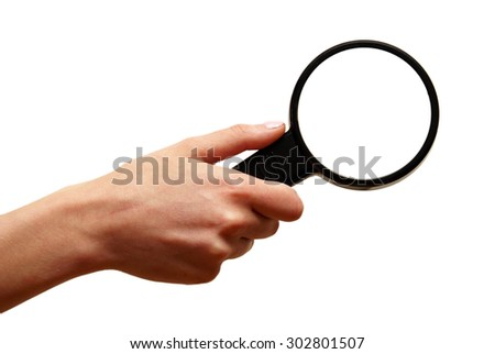 A woman holds a magnifying glass to help her inspections. - stock photo