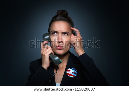 A woman in a business suit characterizing an unsure and confused voter - stock photo