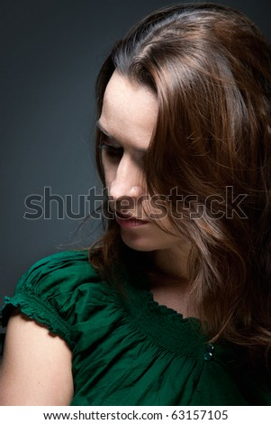 A woman in a dark mood depressed and sad - stock photo