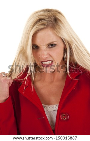 A woman in a red coat standing looks mad - stock photo