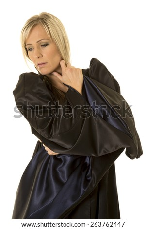a woman in her black and blue midieval dress, in thought. - stock photo