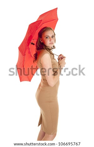 A woman in her business dress holding on to her red umbrella. - stock photo