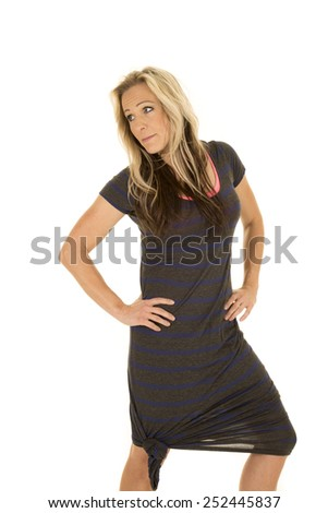 A woman in her dress with her hands on her hips with a funny expression. - stock photo