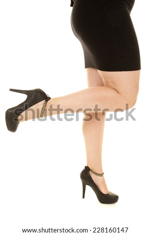 a woman in her dress with her leg up. - stock photo
