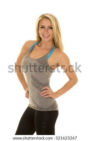 A woman in her fitness clothing showing her fit body. - stock photo