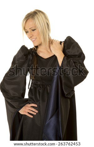A woman in her medieval dress, with a smile on her face. - stock photo