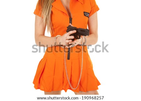 A woman in her orange jail suit with handcuffs on. - stock photo