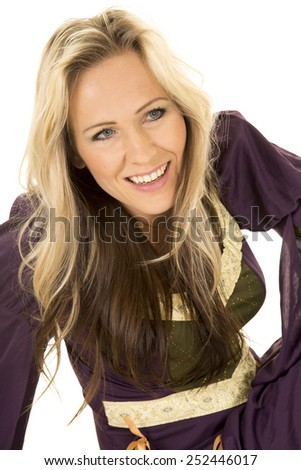a woman in her vintage dress with a big smile on her face. - stock photo