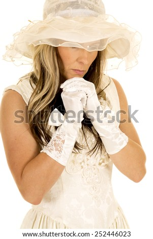 A woman in her vintage dress with a somber expression. - stock photo
